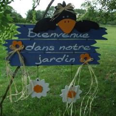 """Pancarte corbeau """"Bienvenue dans notre jardin"""""""